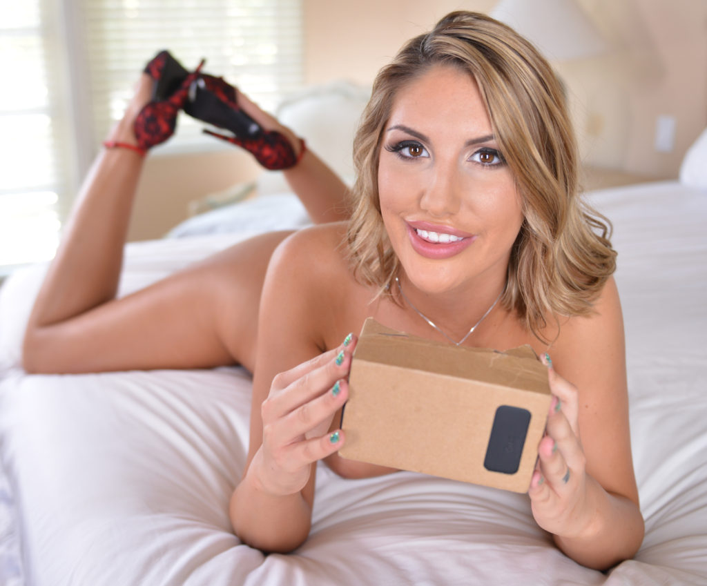 Porn Star August Ames on bed with Google Cardboard