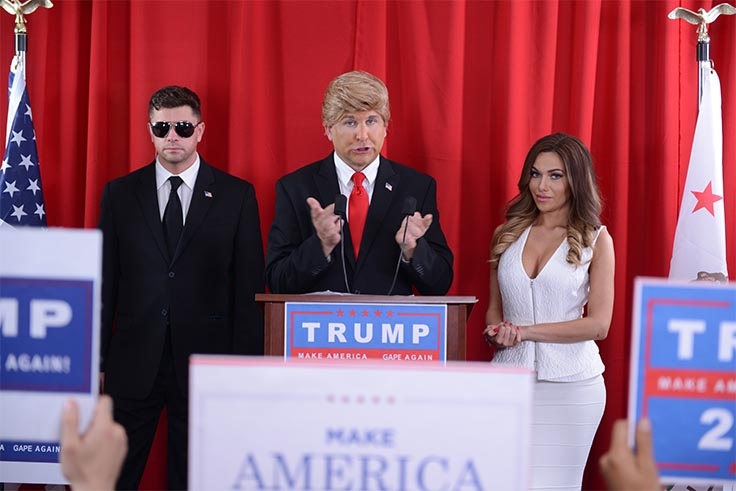 A Donald Trump impersonator is bookended by an extra playing a security guard and a porn star playing Melania Trump in this fake press conference from BaDoinkVR