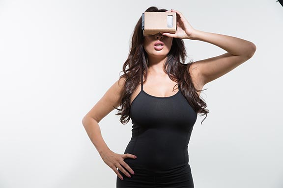 Anissa Kate wearing pair of google cardboard for BaDoinkVR shoot