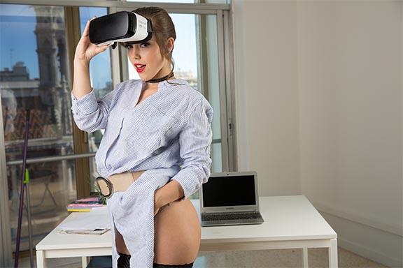 Zoe Doll sporting Gear VR headset in office