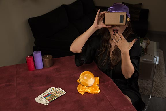Porn star Miriam Prado posing as mystic and wearing Google Cardboard to watch VR Porn