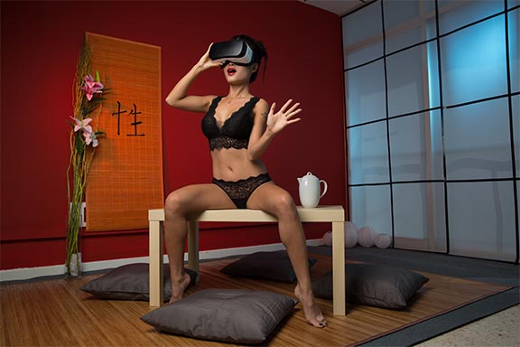 VR porn scene with Gear VR worn by Pussy Cat; backdrop is Japanese tea room