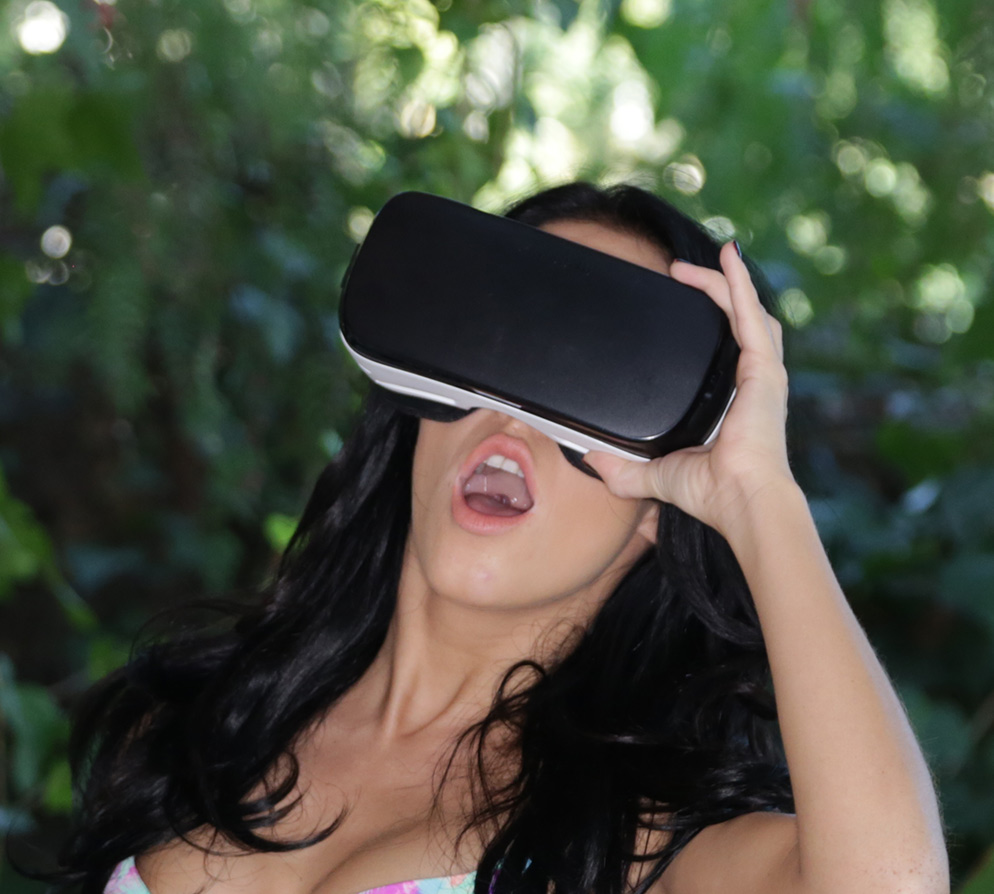 Girl looking through Gear VR headset